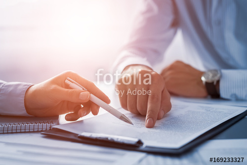 Business people negotiating a contract.